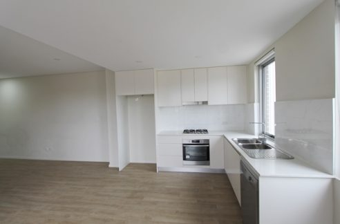 Nearly new, fully tiled 2 Bed/2 Bath/1 Car new apartment for Sale just next to Guildford Train Station.